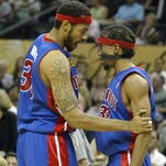 The Detroit Pistons Rasheed Wallace talks to Richard Hamilton in the 3rd quarter as the Detroit Pistons lost 97 to 76 against the San Antonio Spurs in game 2 of the 2005 NBA finals, Sunday June 12, 2005 at the SBC Center in San Antonio, Texas.