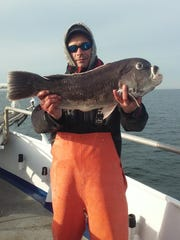 John Munjer from Pine Brook with an 11-pound, 1-ounce blackfish caught on the Norma K III.