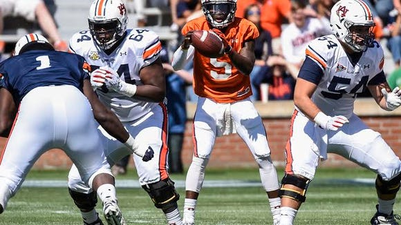 Auburn quarterback John Franklin III takes a snap during