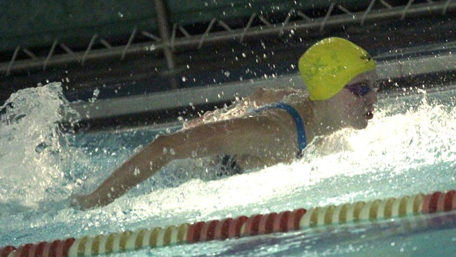 Colonel Crawford's Kaisey Speck competes in the 200 IM during the sectional swim meet at Malabar Middle School on Saturday.