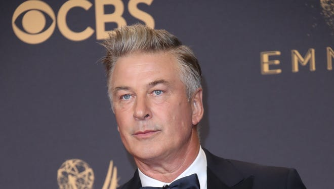 Alec Baldwin poses with his Emmy award backstage at the Emmys.