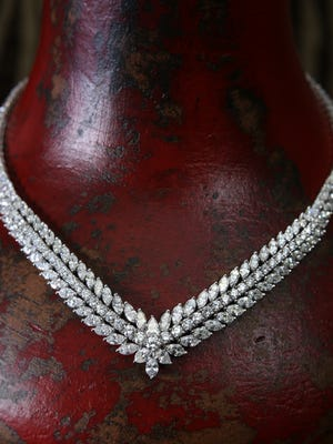 """Platinum diamond """"V"""" necklace, 16 inches long with 213 diamonds, 34.13 carats. $52,000.00 from Lockhart Jewelers Inc. in Shreveport."""