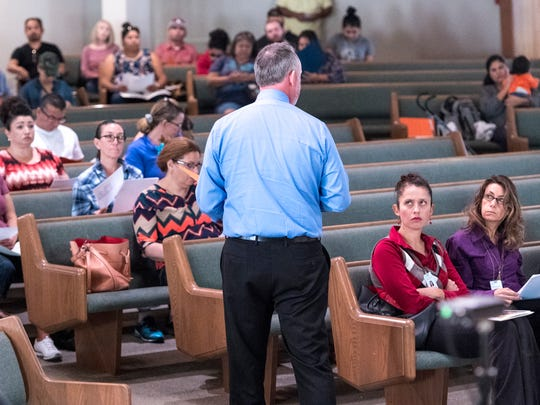 About 80 of the 500-plus employees from Tulare Regional Medical Center facing unemployment listen to Jonathan Thompson from the Employment Connection speak Monday, October 30, 2017 at Tulare First Baptist Church. Additional sessions for information are available.