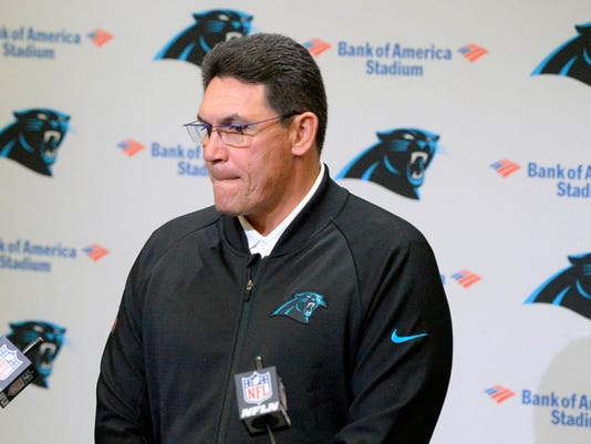 Carolina Panthers NFL football head coach Ron Rivera pauses to answer a question about the allegations against team owner Jerry Richardson, and the announced sale of the team at the end of the season, during a weekly press conference at Bank of America Stadium on Monday, Dec. 18, 2017. (David T. Frost III/The Charlotte Observer via AP)
