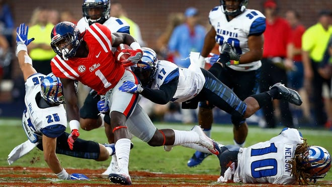 October 1, 2016 - University of Memphis defensive back Chris Morley (right) brings down Ole Miss A.J. Brown (left) during first quarter action at Vaught-Hemingway Stadium in Oxford, Miss.