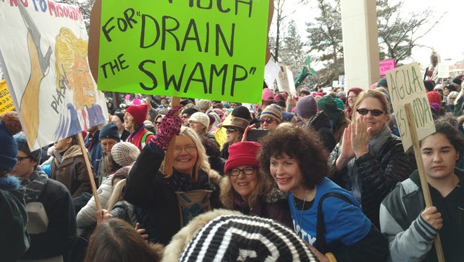 Mary Maxson, Joyce Westerbur and Gail Price, foreground, joined the Women's March protest last Saturday in Santa Fe.