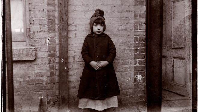 """This photo by Jacob A. Riis, part of the exhibit opening in April at the Hayes Presidential Library and Museum, features """"Little Katie from the West 52nd Street Industrial School"""" and was taken in 1891 or 1892."""
