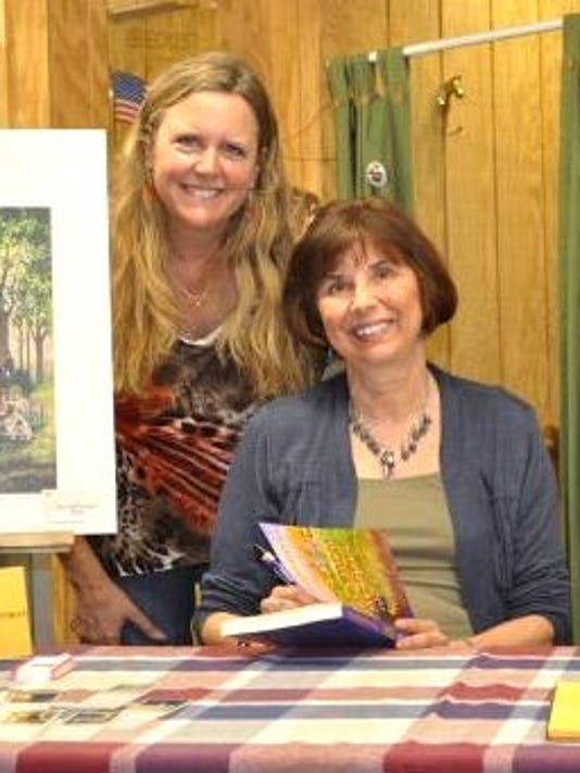 Lori Lehman, left, owner of TackRoom Treasures, stands with author Jill Pritchett at her book signing Aug. 18. (SUBMITTED)