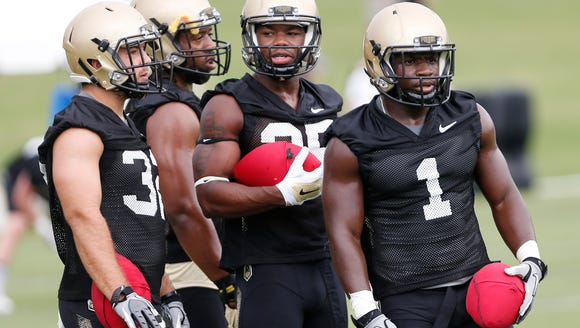 D.J. Knox, right, and the running backs prepare to