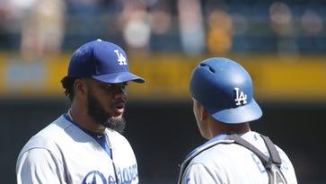 Dodgers' Kenley Jansen  celebrates with catcher A.J.