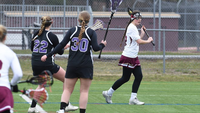 Arlington's Danielle DiLorenzo, right, looks for an open teammate during Saturday's game against Monroe-Woodbury.