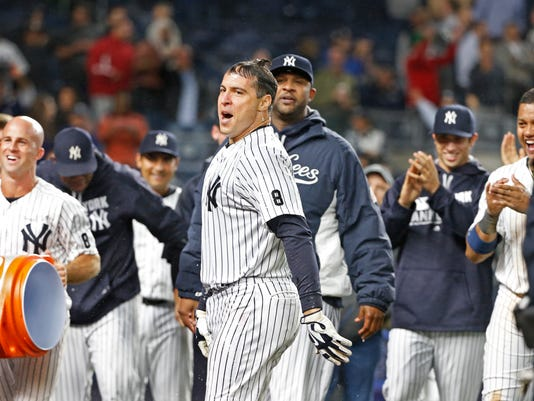 New York Yankees' Mark Teixeira , center, reacts after teammates doused him with ice water and Gatorade after hitting a ninth-inning, walk off grand slam in a baseball game against the Boston Red Sox in New York, Wednesday, Sept. 28, 2016. Yankees pitcher CC Sabathia is just to the right of Teixeira. (AP Photo/Kathy Willens)