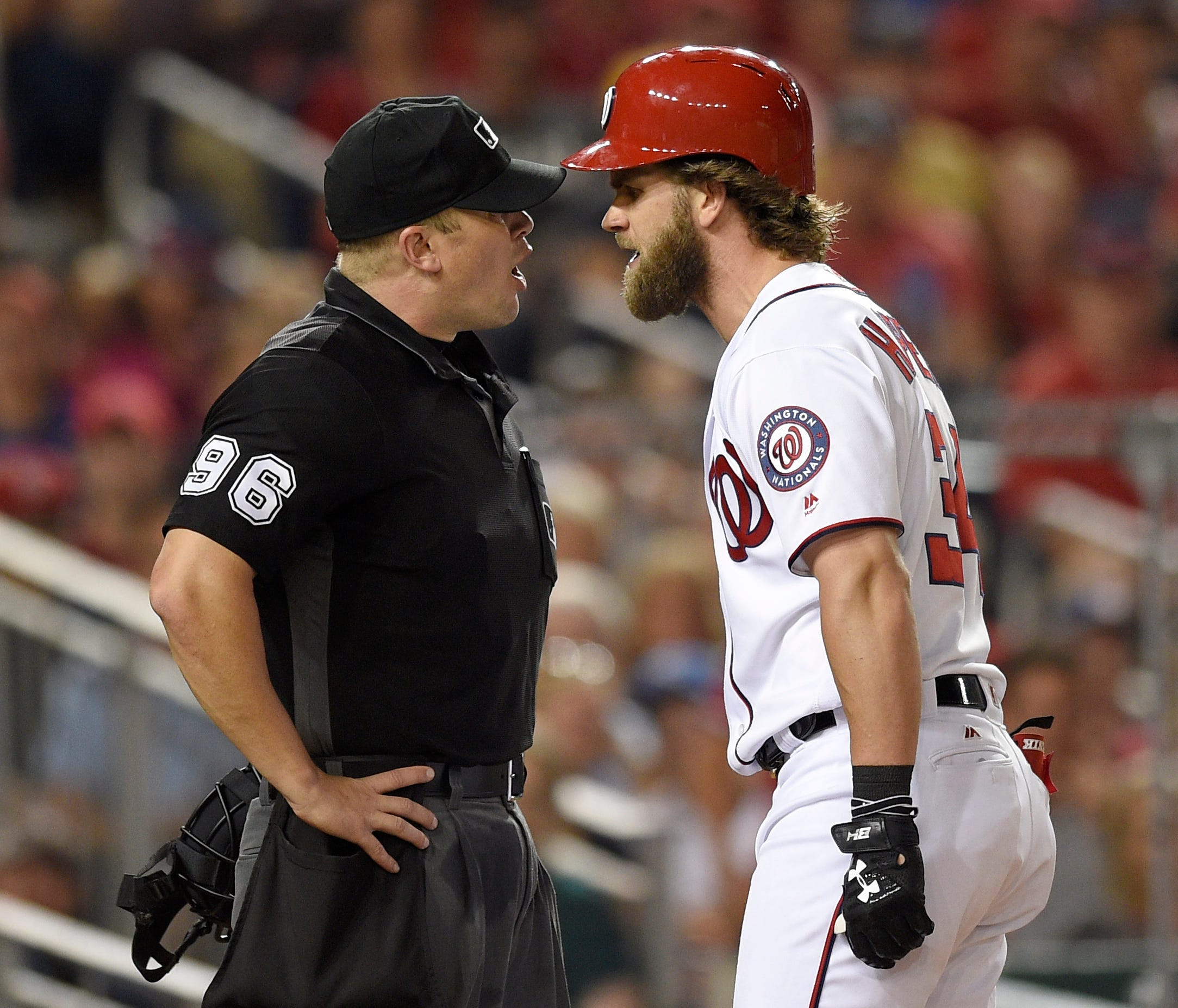 Washington Nationals' Bryce Harper (34) argues after he was ejected from the baseball game by home plate umpire Chris Segal, left, after he struck out during the eighth inning against the Milwaukee Brewers, Wednesday, July 26, 2017, in Washington. Th