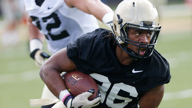 Running back Richie Worship turns the corner and looks up field after a pass reception during football practice Thursday, August 4, 2016, at the Bimel Practice Complex on the campus of Purdue University.