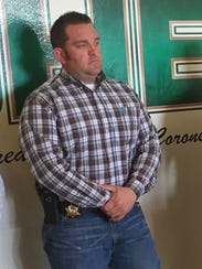 Mike Yandell stands during a press conference.