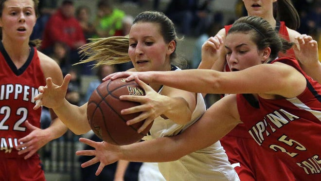 Appleton North's Sydney Levy, middle, and Lexi Hanley of Chippewa Falls fight for a rebound in a non-conference game at Appleton North High School.
