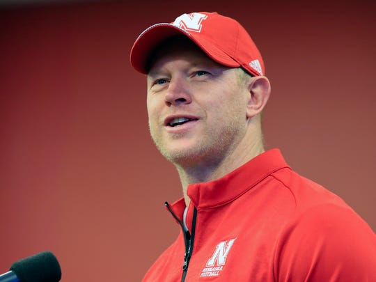 FILE - In this March 14, 2018, file photo, Nebraska NCAA college football coach head Scott Frost answers questions during a news conference in Lincoln, Neb. The hottest coach in America came home in December and pledged to bring back the master plan Bob Devaney and Tom Osborne devised to pile up wins at an unprecedented rate from the 1960s through the '90s. (AP Photo/Nati Harnik, File)