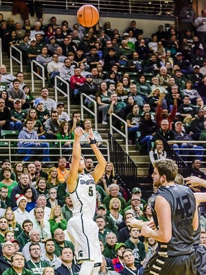 MSU's Bryn Forbes knocks down a 3-point shot during the Spartans' game with Oakland Sunday in East Lansing.