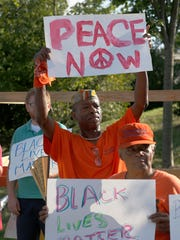 Ronald Cephus of the Wilmington Peacekeepers demonstrates during the First Unitarian Church's vigil in support of Black Lives Matter on Concord Pike late Wednesday afternoon.