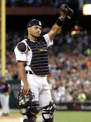 Tigers catcher Ivan Rodriguez acknowledges the Comerica Park applause at the start of the 6th inning against the Indians after it was announced he had officially caught his 2,000 career game, July 3, 2007.