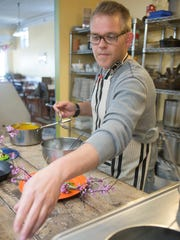 Mike Lund of LUNdCH in Staunton prepares a dish of fresh pappardelle, carrot puree, peas, vidalias and foraged ramps and redbuds.