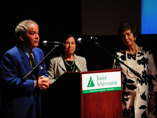 Bill Bacque of Van Eaton & Romero, joined by Gail Romero and Nancy Van Eaton Broussard, accepts the award for Large Business of the Year during the Junior Achievement of Acadiana's Business Hall of Fame ceremony at the Acadiana Center for the Arts in Lafayette, LA, May 7, 2013.