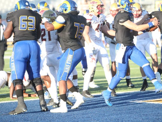 Angelo State University quarterback Charlie Rotherham (right) scores on a 1-yard touchdown run during a Lone Star Conference game against No. 6 Midwestern State at LeGrand Stadium at 1st Community Credit Union Field on Saturday, Oct, 14, 2017. MSU handed ASU a 41-27 defeat.