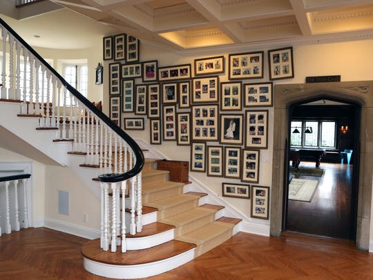 "The grand staircase, with the ""man cave"" at right"