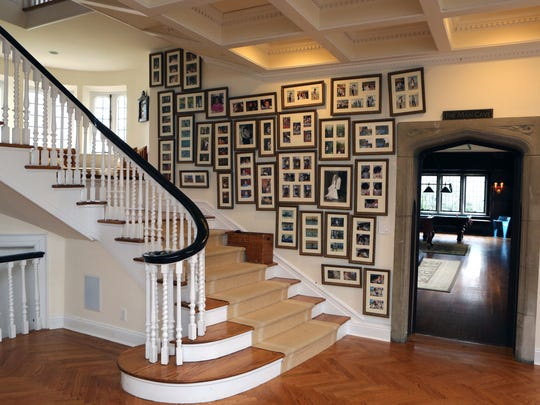 """The grand staircase, with the """"man cave"""" at right"""