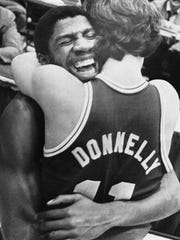 "Michigan State's Earvin ""Magic"" Johnson hugs Terry Donnelly after the Spartans beat Notre Dame, 80-68, to win the NCAA Mideast Regional Championship game in Indianapolis on Sunday, March 18, 1979."