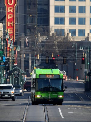 February 11, 2015 - Green busses have temporarily replaced the vintage trollies along the Main Street loop and Madison Avenue. The task of reviving the MATA trolly system has become so costly and complicated that transit officials are considering buying or leasing modern vehicles. (Mike Brown/The Commercial Appeal)