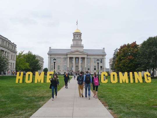 Students walk Monday near the Old Capitol, where a