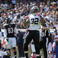 CHICAGO, IL - OCTOBER 06: Kenny Vaccaro #32 of the New Orleans Saints reacts after sacking Jay Cutler #6 of the Chicago Bears on October 6, 2013 at Soldier Field in Chicago, Illinois. (Photo by David Banks/Getty Images)
