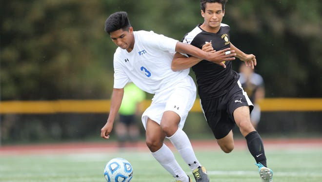 Piero Urteaga (3) and Passaic Tech shields the ball in a game against Eastside in the county tournament.