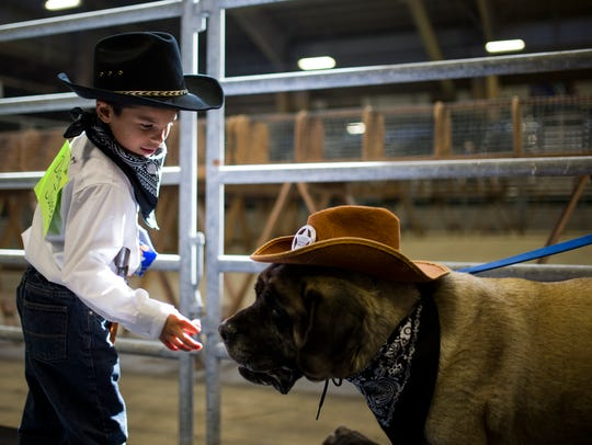Damien Juarez, 6, feeds his dog Nala a treat before