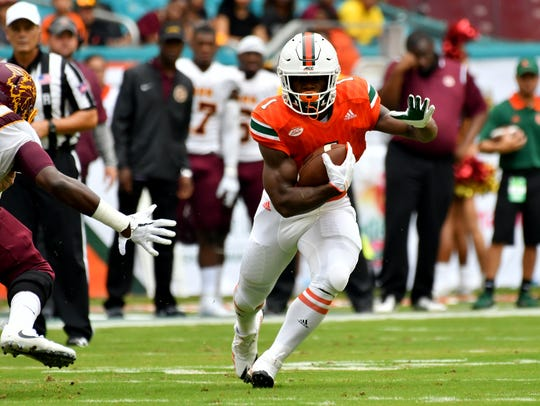 Miami Hurricanes running back Mark Walton (1) carries