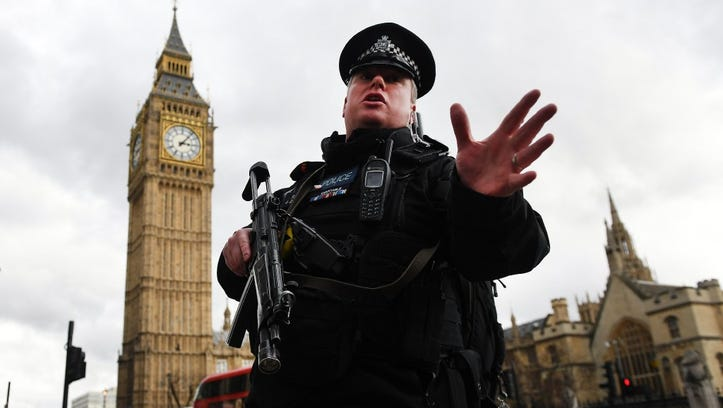 Armed police push people back following major incidents