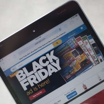 "A ""Black Friday"" advertisement for Walmart is seen on an iPad"