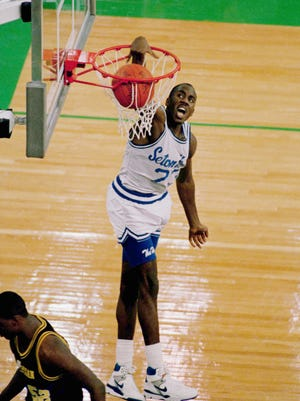 Seton Hall's John Morton slamming home two of his 35 points in a losing effort  to Michigan in the 1989 NCAA championship game in Seattle's Kingdome,