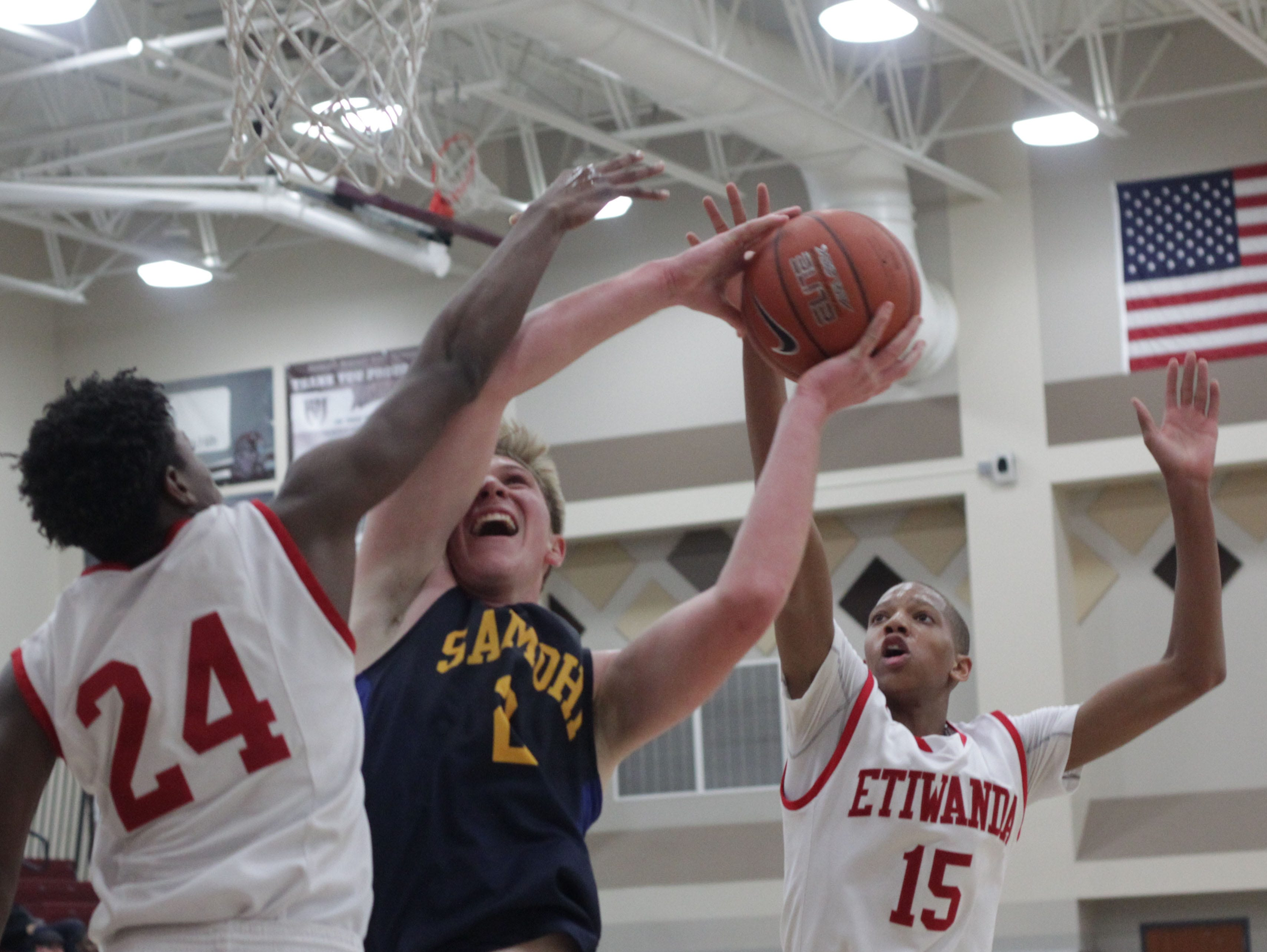 Daniel Schreier, of Santa Monica, overpowers through two Etiwanda players during the MaxPreps Holiday Classic basketball tournament at Rancho Mirage High School.