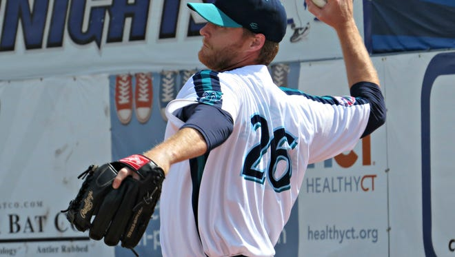 Flashing a knuckleball grip, long-time major-league infielder Dan Johnson debuted as a pitcher for the Bridgeport Bluefish against the Somerset Patriots on Wednesday morning.  Bridgeport won the first game of the doubleheader, 7-5.