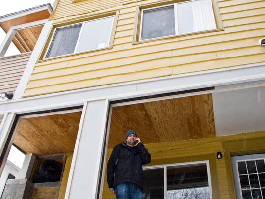 Richmond resident Robert Hintze, who owns eight apartment buildings in the Burlington area, conducts business at one of his properties on South Winooski Avenue in early February.