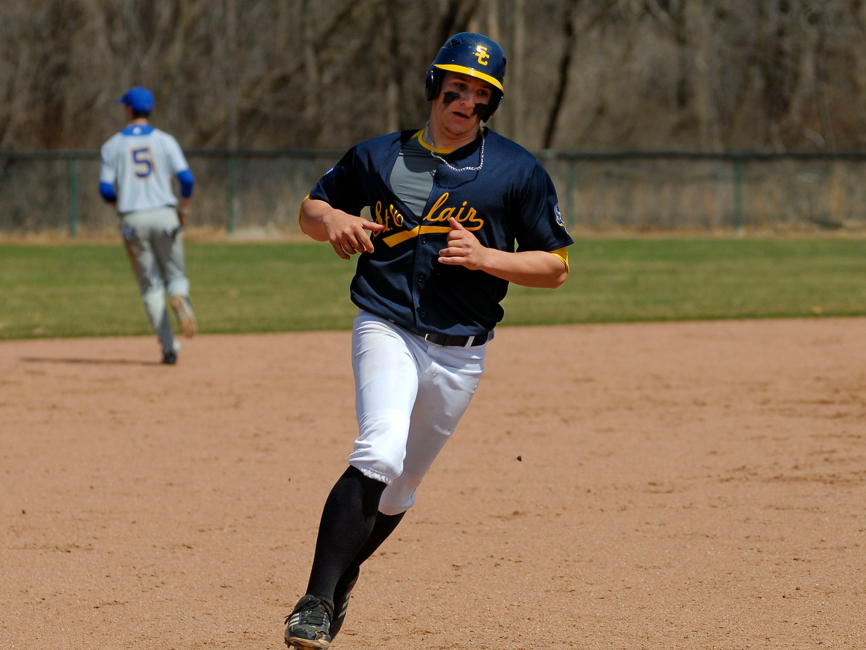 Mitchell Ward runs around third base April 12 during a game against Ancilla College.