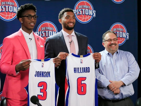 The Detroit Pistons new draft picks, Stanley Johnson (3) and Darrun Hilliard, (6) stand with Pistons head coach and president Stan Van Gundy at a news conference, Saturday, June 27, 2015, in Auburn Hills, Mich.