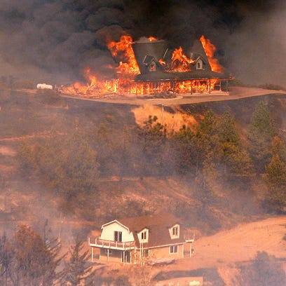 UPDATE: Heat wave intensifies wildfire threatening homes
