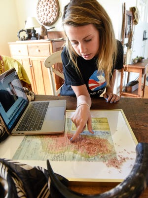 Brianna Backes talks about her work for the Peace Corps in a rural health clinic in Madagascar during an interview Wednesday, July 26, at her home near Sauk Rapids.