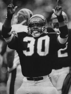 """Cincinnati Bengals rookie fullback Ickey Woods does a dance he calls the """"Ickey Shuffle"""" after scoring a touchdown in this Nov. 27, 1988, file photo. Woods scored three touchdowns in the Bengals 35-21 win over the Buffalo Bills."""