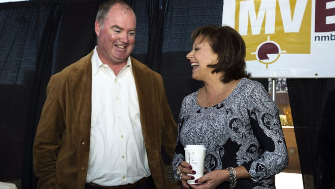 New Mexico Gov. Susana Martinez, right, shares a laugh with X2nSat Chief Garrett C. Hill on Friday, Oct. 14, 2016, after announcing the new technology-related jobs the satellite company will bring to Las Cruces.