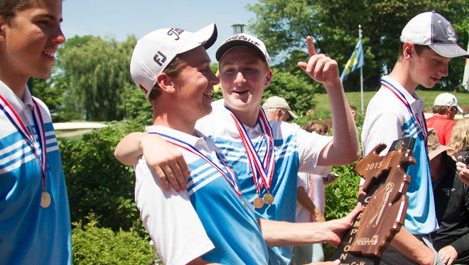 Lansing Catholic golfers celebrate their Division 3 State Championship on Saturday at Forest Akers West in East Lansing.