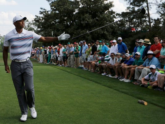Tiger Woods of the U.S. tosses his driver after hitting off the ninth tee and sending the ball onto the first fairway during first round play of the Masters golf tournament at the Augusta National Golf Course in Augusta